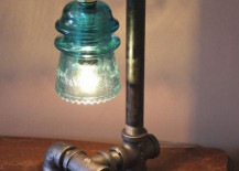 Industrial style pipe lamp with green glass insulator 217x155 15 Edgy and Industrial Table Lamps