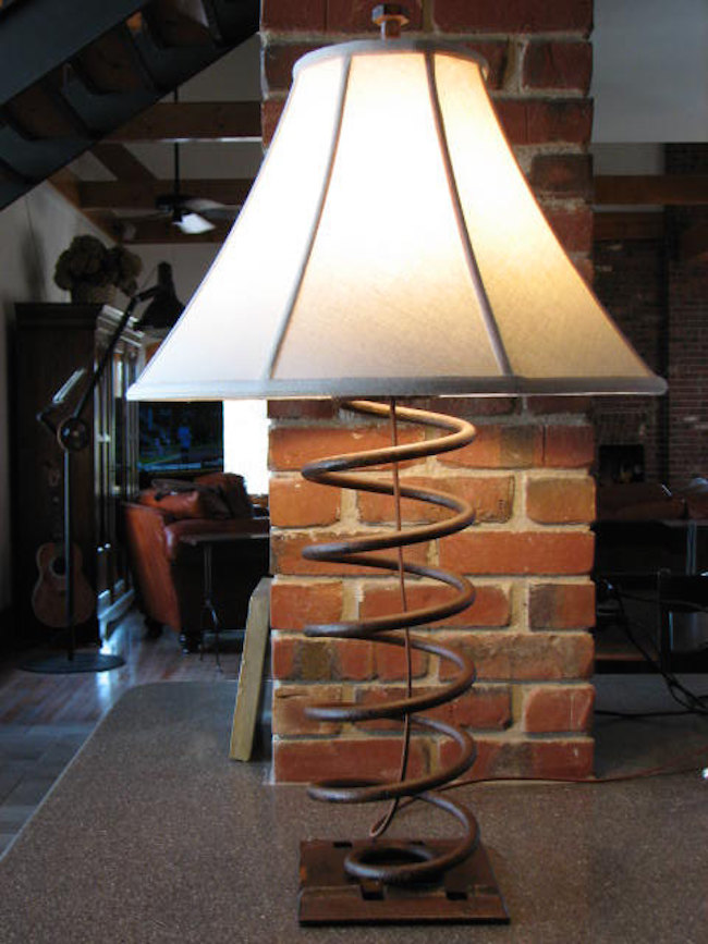 Industrial table lamp made from an old truck spring