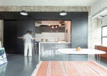 Ingenious way to hide your kitchen using sliding metallic panels