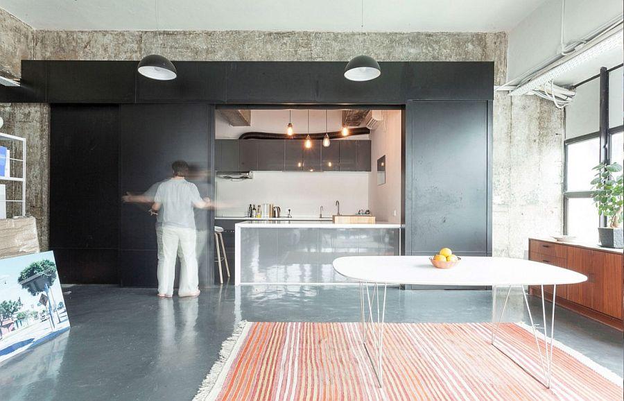 Ingenious way to hide your kitchen using sliding metallic panels