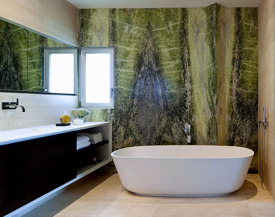Irish green marble creates a vivacious accent wall in the contemporary bathroom [Design: Domb architects]