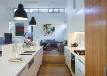 Kitchen in white with marble and stone finishes and wooden shelves
