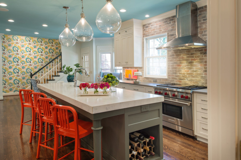Kitchen with a blue ceiling and bright orange bar stools
