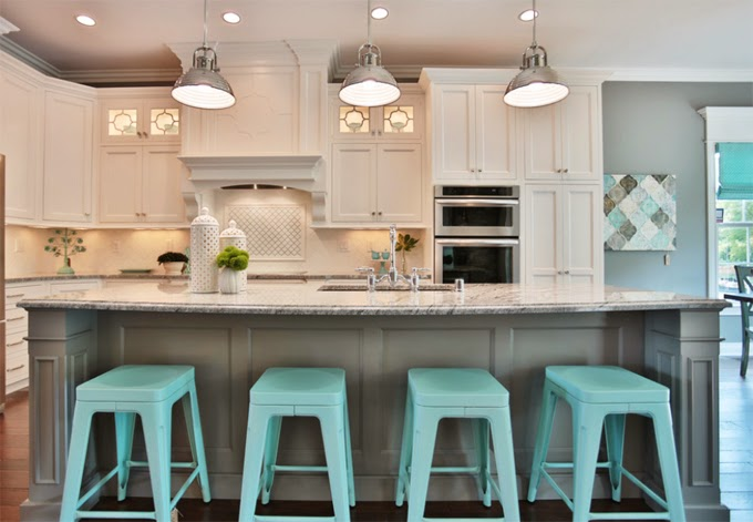 Kitchen with stunning light turquoise bar stools