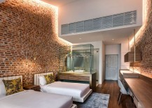 LED cove lighting for the brick walls creates a cozy, etheral setting inside the suites