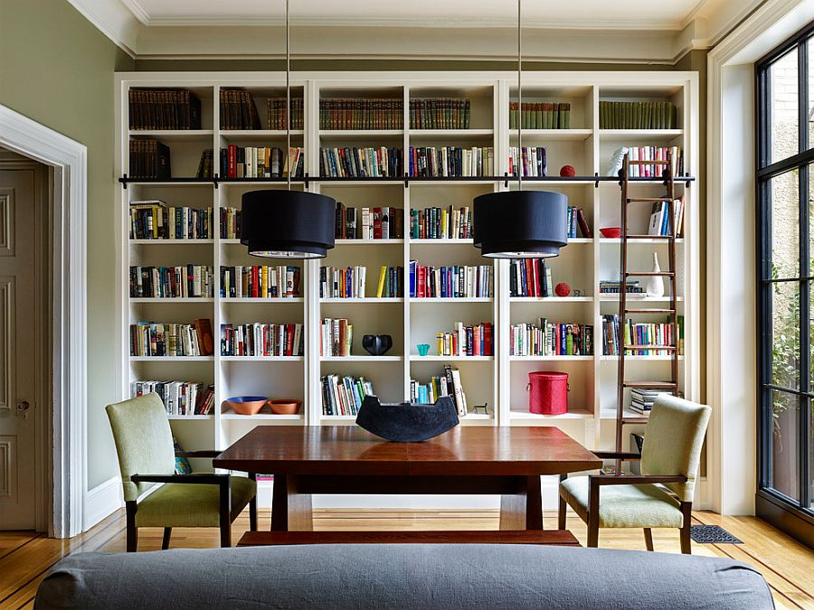 Ladder, bookshelves and bold pendants for the modern library [Design: Rasmussen / Su Architects / Jeffrey Totaro Photographer]