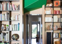 Large-bookshelves-and-wooden-walls-separate-spaces-inside-the-Dolls-House-217x155