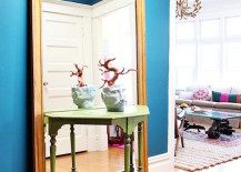 Large full length mirror behind a small entryway table 217x155 18 Entryways with Captivating Mirrors