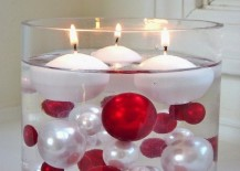 Large glass cylinder with Christmas ball ornaments and floating candles 217x155 17 Easy DIY Holiday Candle Holders