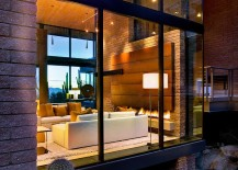 Large-glass-wall-blurs-the-line-between-interior-and-landscape-outside-217x155