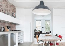 Large-industrial-style-pendant-in-gray-adds-personality-to-the-small-dining-room-kitchen-combo-217x155