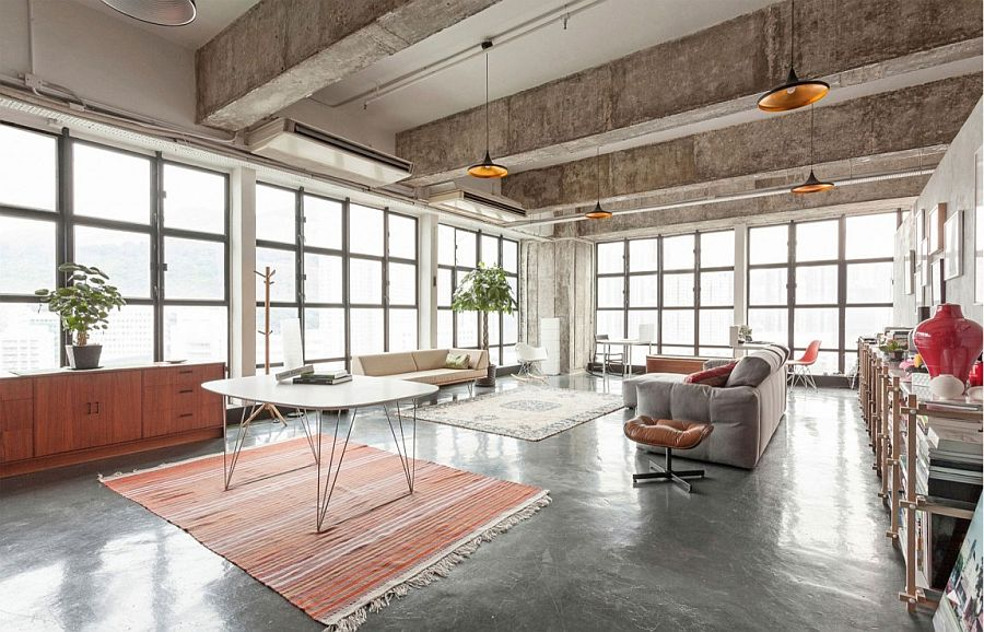 Large living space with industrial-style windows and Tom Dixon pendant lights