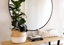 Large-round-mirror-above-a-wood-bench-217x155