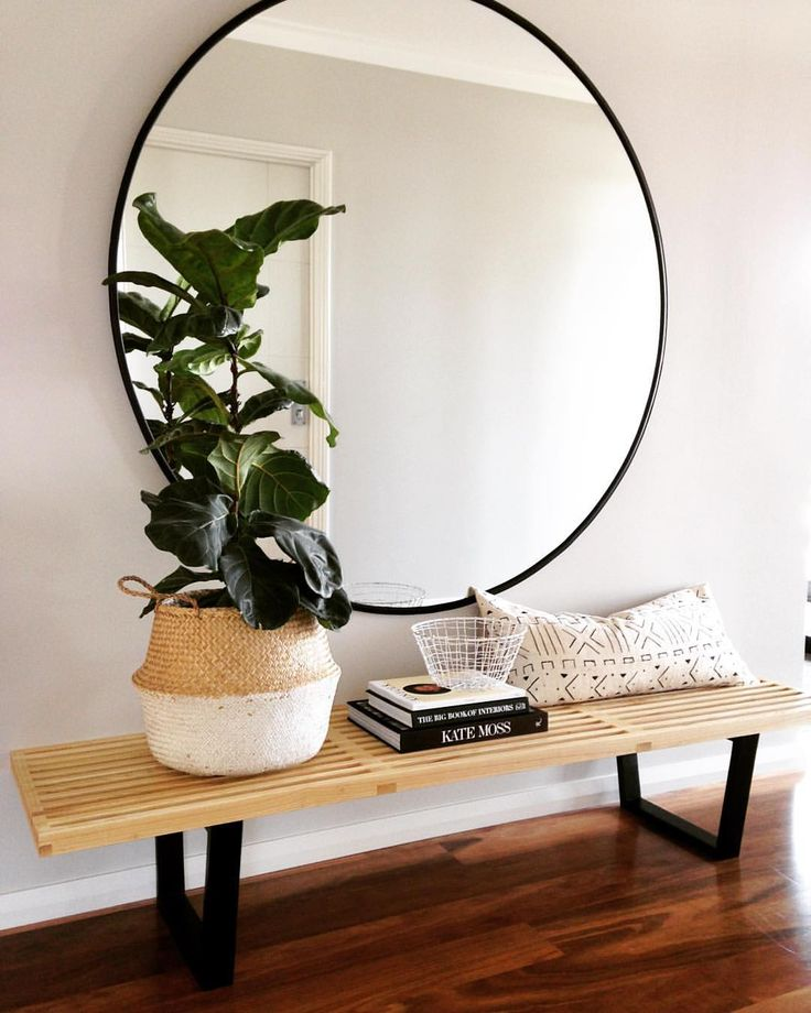 In your entryway keep it simple, and use a large mirror to invite good Qi into your home.