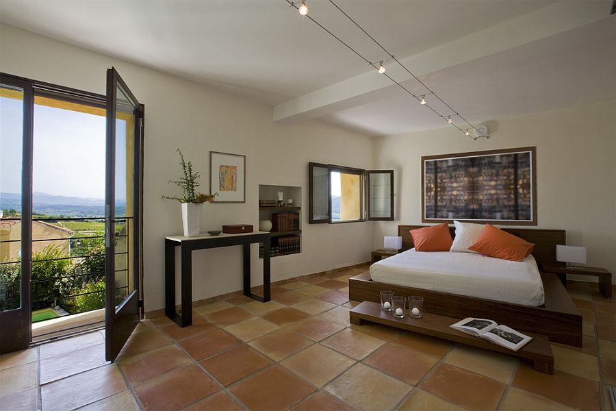 Large terra-cotta tile brings country charm to the luxurious contemporary bedroom [Design: Ernesto Santalla]