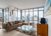 Large windows of the corner condo completely open it up to the view outside 217x155 Hot Property: Luxury Condo in Vancouver for the Hip Urban Denizen