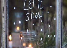 Let It Snow written on window in temporary white window marker 217x155 7 Festive Decorations to Hang in Your Windows for the Holidays