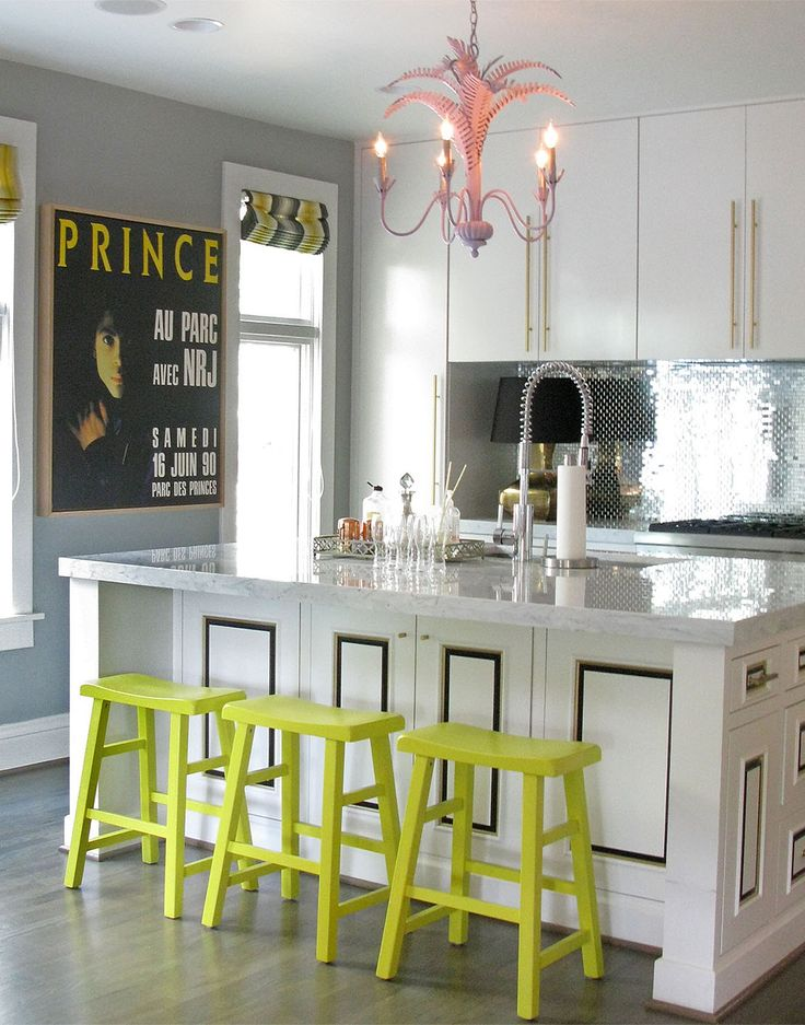 Lime green bar stools and small accents in a kitchen