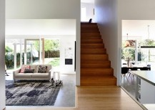 Living areas on the lower elvel of the extension with narrow staircase leading to the top floor 217x155 Wavy Modern Extension Enlivens 1920s Californian Bungalow in Hobart