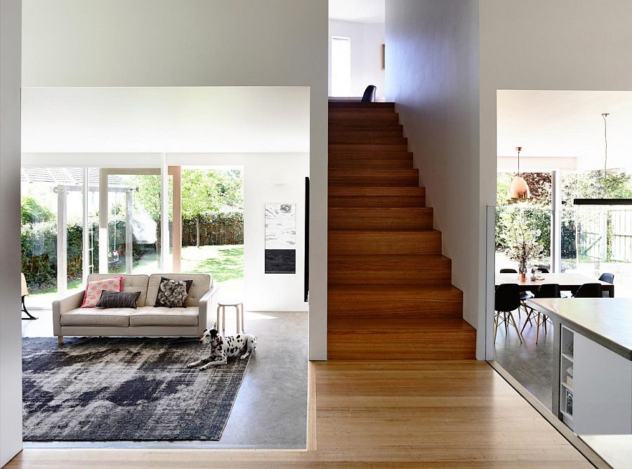 Living areas on the lower elvel of the extension with narrow staircase leading to the top floor