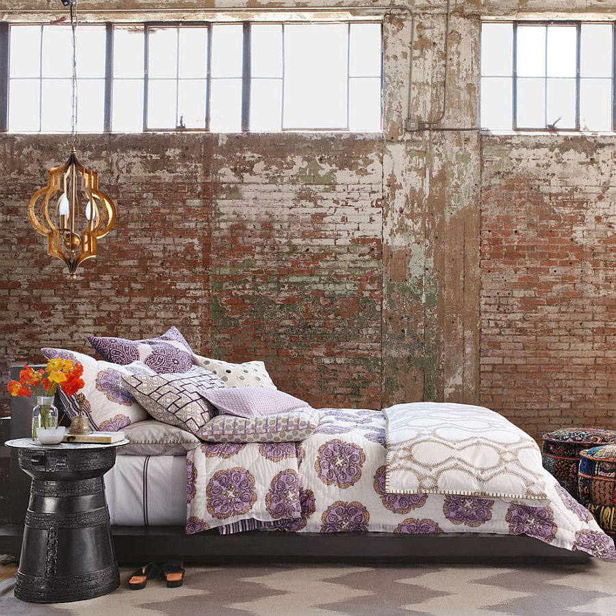 Lovely way to style a modern bedroom with exposed brick walls [From: Horchow]