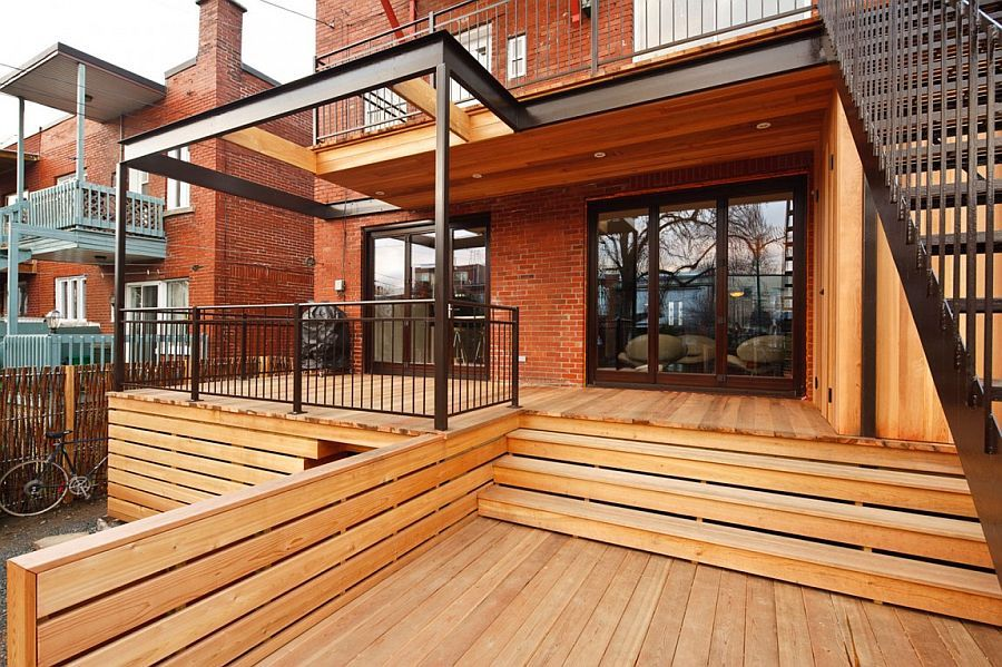 Lovely wood and brick exterior of Condo Louis Hébert in Montreal 1 Condo Louis Hébert: Cozy Montreal Duplex Filled with Vibrant Decor