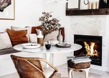 Marble fireplace and Saarinen Tulip Table bring timeless elegance to the dining space