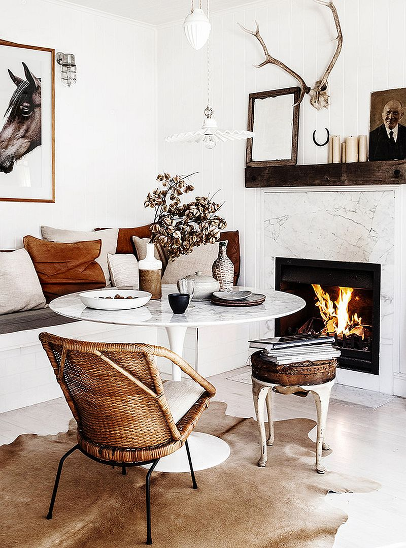 Marble fireplace and Saarinen Tulip Table bring timeless elegance to the dining space [Design: Kara Rosenlund]