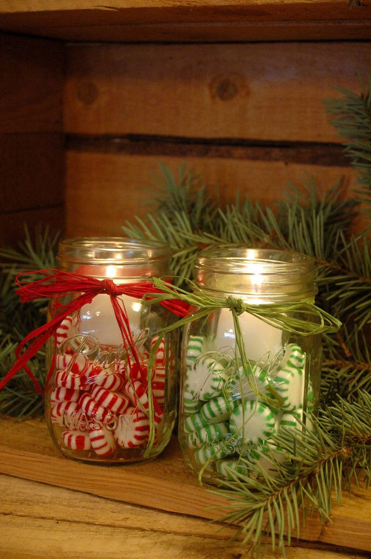Mason jars filled with Christmas candies and candles