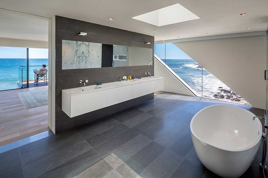 Master bathroom seamlessly connected with the bedroom and the view outside [Design: Mark Dziewulski Architect]