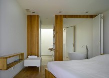 Master-bedroom-and-bathroom-become-one-with-the-use-of-stackable-doors-217x155