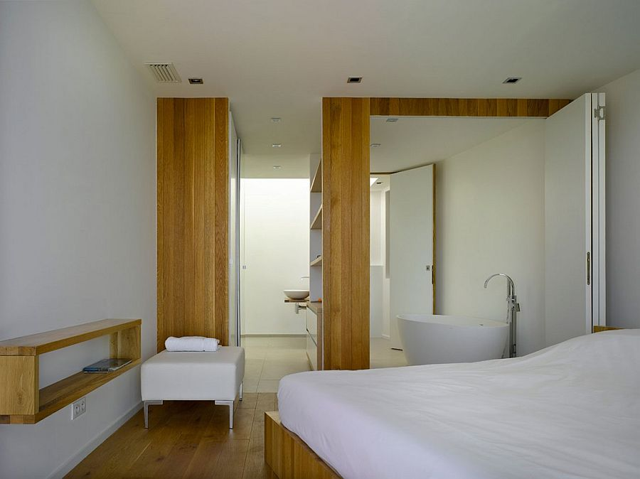 Master bedroom and bathroom become one with the use of stackable doors