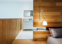 Master bedroom with custom wooden headboard wall and cool sconce lighting