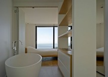 Master-suite-of-the-French-villa-with-a-view-of-the-distant-sea-217x155