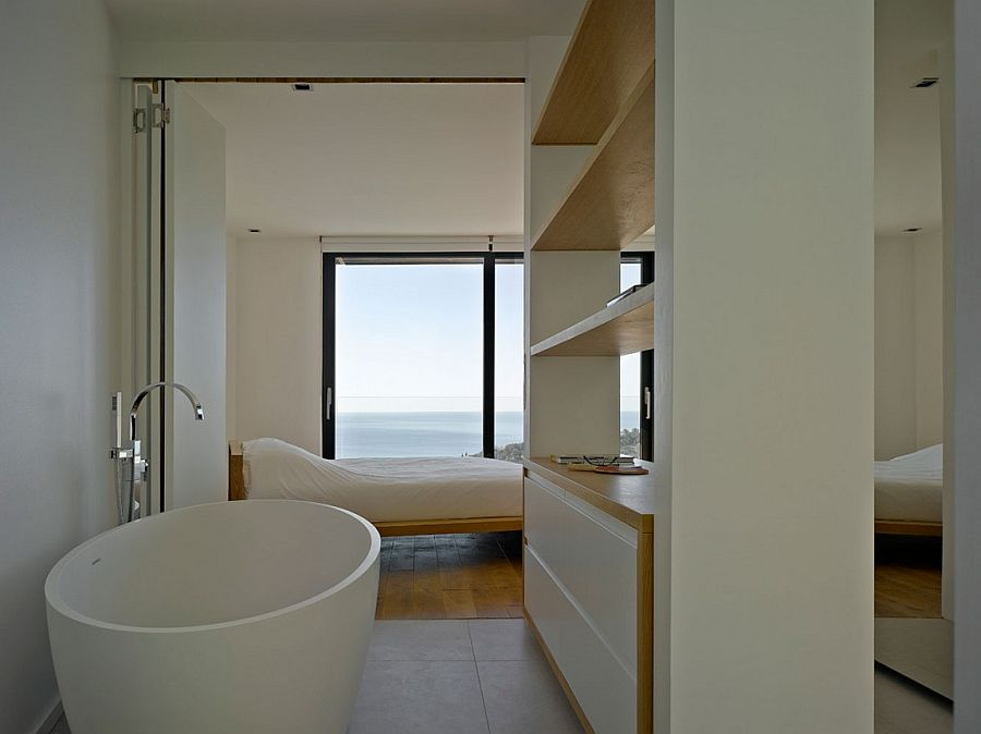 Master suite of the French villa with a view of the distant sea