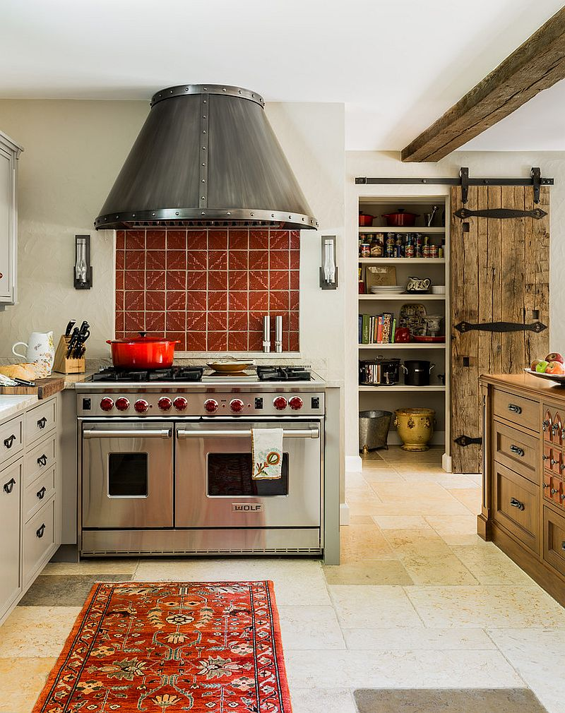 Mediterranean kitchen with reclaimed barn door for the pantry