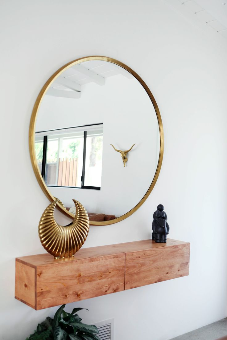 Minimal Entryway Decor With A Large Round Mirror Gold Frame