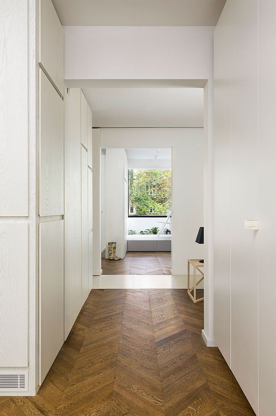 Minimal shelves and chevron patterm flooring for the smart apartment