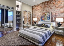 Mirrored closet doors give the bedroom a more spacious look