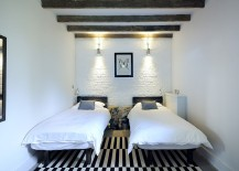 Modern-and-farmhouse-styles-rolled-into-one-inside-the-modest-bedroom-217x155