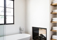 Modern bathroom with dual fireplace