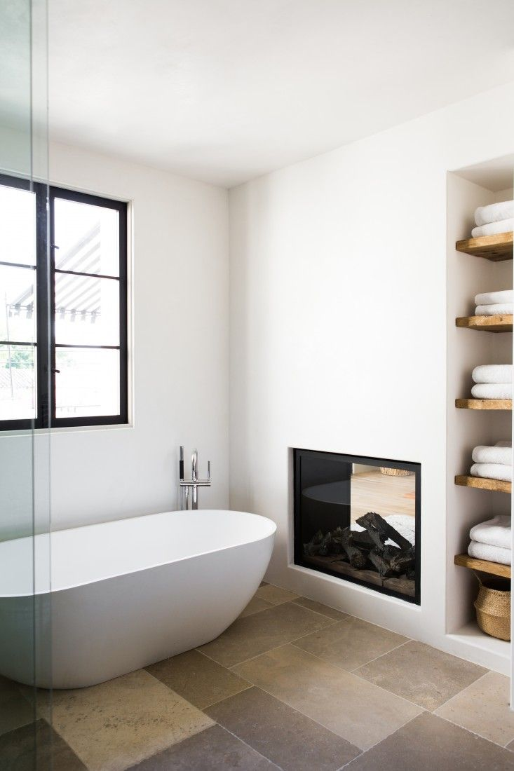 View In Gallery Modern Bathroom With Dual Fireplace