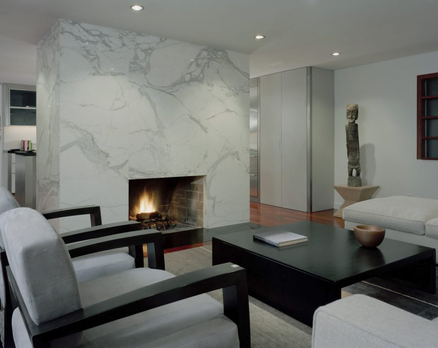 Modern living room with a sleek marble fireplace
