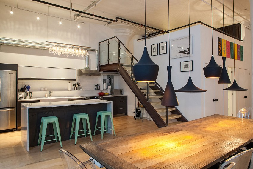 Modern loft apartment with green bar stools in the kitchen