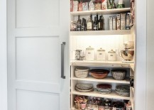 Modern pantry design with an elegant sliding barn door