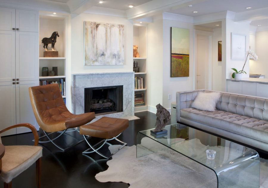 Modern white living room with a marble fireplace
