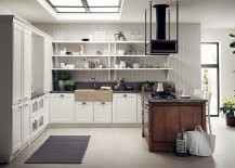 Natural beauty of the woodsy kitchen island stands in contrast with the refined backdrop