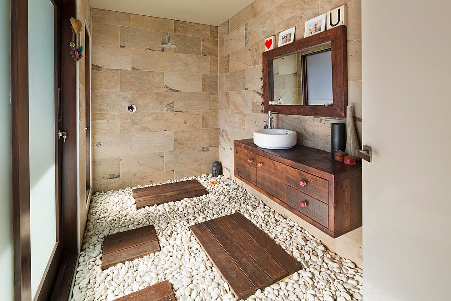 Natural stone and pebbles create an exotic, tropical style bathroom [Design: Henarise Pty Ltd / Photography: Cameron Ramsay]