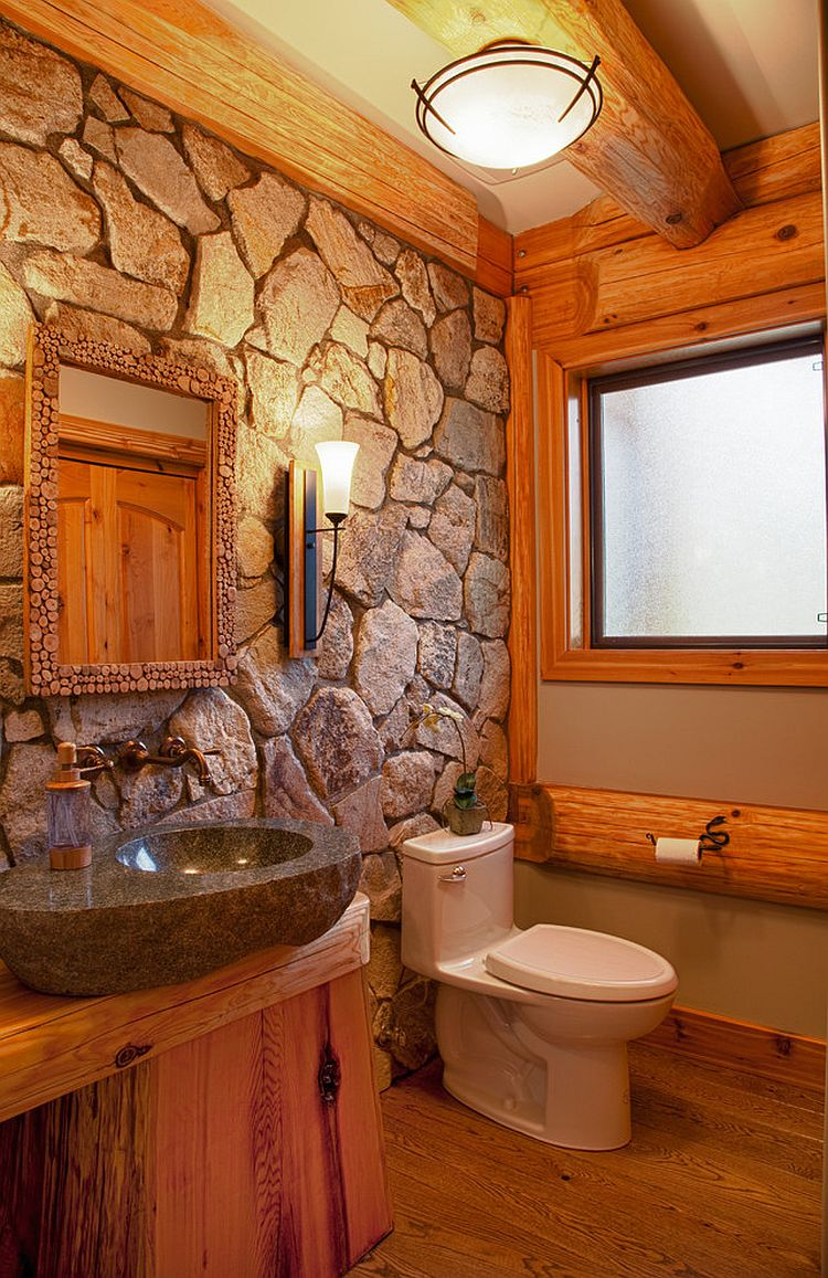 Natural stone wall for the cabin style rustic bathroom [Design: Traditional Log Homes Ltd]