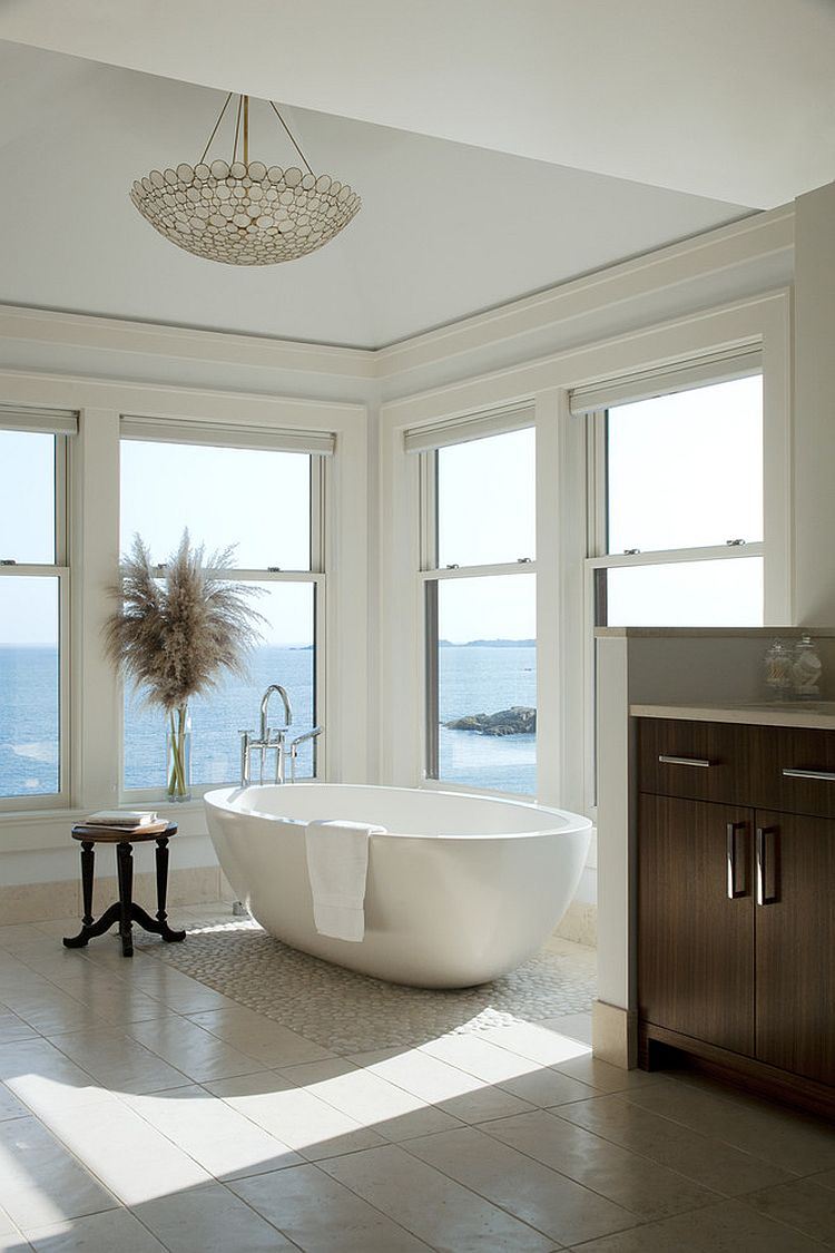 Neutral hues let the view on offer shine through in the master bath [Design: LDa Architecture & Interiors]